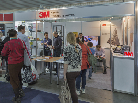 conglomerate: KIEV, UKRAINE - OCTOBER 11, 2015: People visit 3M, American multinational conglomerate corporation booth during CEE 2015, the largest electronics trade show of Ukraine in ExpoPlaza Exhibition Center