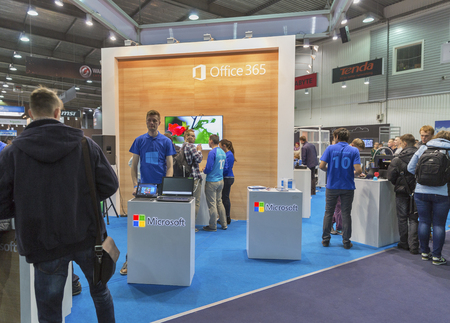 internet explorer: KIEV, UKRAINE - OCTOBER 11, 2015: People visit Microsoft, American multinational technology company booth during CEE 2015, the largest electronics trade show of Ukraine in ExpoPlaza Exhibition Center