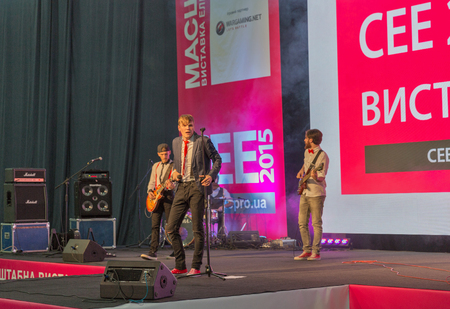 unrecognized: KIEV, UKRAINE - OCTOBER 11, 2015: Unrecognized rock band performance during CEE 2015, the largest electronics trade show of Ukraine in ExpoPlaza Exhibition Center.