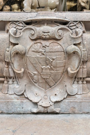 residenz: Ancient coat of arms at famous Residenz Fountain in Salzburg, Austria.