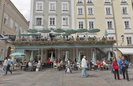 unrecognized: SALZBURG, AUSTRIA - SEPTEMBER 09, 2015: Unrecognized people visit famous Tomasseli Cafe , the oldest cafe in city. Salzburg is the 4th biggest city in Austria.