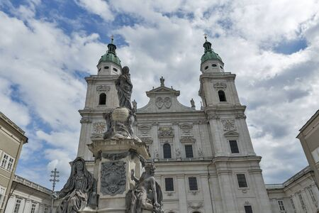 graf: Statues of Immaculate Column Virgin Mary by Wolfgang and Johann Baptist Hagenauer for Archbishop Sigismund Graf Schrattenbach in Salzburg, Austria. Catholic Cathedral Dom in the background. Editorial