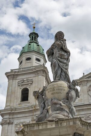 archbishop: Statue of Immaculate Column Virgin Mary sculpted by Wolfgang and Johann Baptist Hagenauer for Archbishop Sigismund Graf Schrattenbach in Salzburg, Austria. Catholic Cathedral Dom in the background