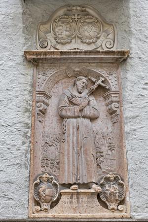 bas relief: Outdoor wall bas relief in Franciscan Church Franziskanerkirche located in Salzburg, Austria