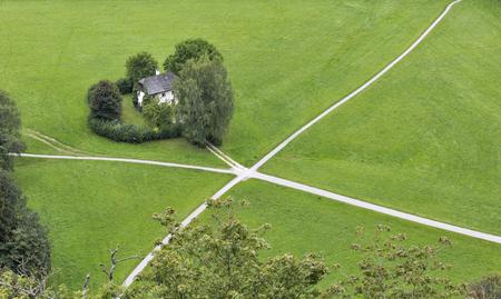 xanadu: House standing on the crossroad in the field. Salzburg suburb, Austria. Editorial