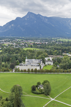 xanadu: Suburbs of Salzburg Austria, looking out towards the beginnings of the Alps. Stock Photo