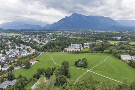 suburbs: Suburbs of Salzburg Austria, looking out towards the beginnings of the Alps. Stock Photo