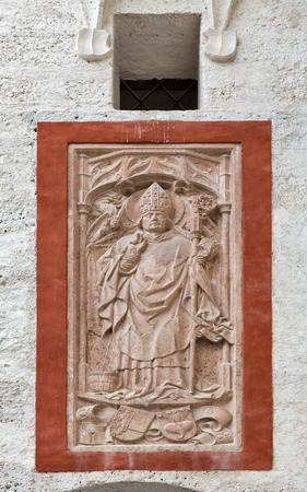 bas relief: Ancient bas relief with priest closeup on the wall of fortress Hohensalzburg in Salzburg, Austria.