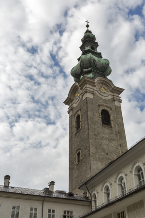 collegiate: St. Peter Collegiate Church clock tower in Salzburg, Austria