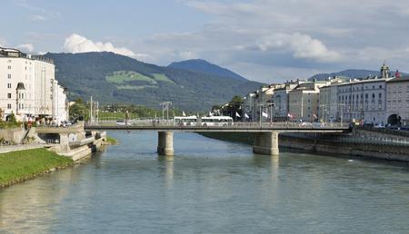 salzach: Cityscape with Salzach river and Staatsbrucke bridge in Salzburg, Austria Stock Photo