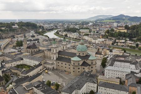 salzach: Aerial view over Salzburg historic city center with Franciscan Church Fraziskanerkirche, Catholic Cathedral Salzburger Dom and Salzach river, Austria Stock Photo