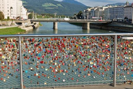 salzach: Bridge with love locks and Salzach river in in Salzburg, Austria.