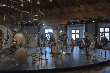refurbished: SALZBURG, AUSTRIA - SEPTEMBER 09, 2015: Exhibit of medieval weapons and war garments in Hohensalzburg Fortress. It was refurbished from the late 19th century and became a major tourist attraction. Editorial