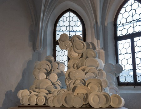 refurbished: SALZBURG, AUSTRIA - SEPTEMBER 09, 2015: White plates installation by unknown author in Hohensalzburg Fortress. Fortress was refurbished from the late 19th century and became a major tourist attraction