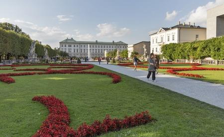 graf: SALZBURG, AUSTRIA - SEPTEMBER 09, 2015: Unrecognized people walk in world famous Gardens of Mirabell. The Gardens were redesigned around 1690 under Johann Ernst Graf von Thun.
