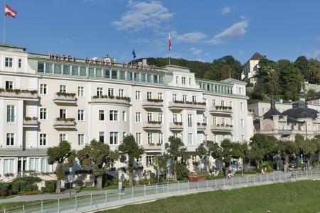 salzach: SALZBURG, AUSTRIA - SEPTEMBER 09, 2015: Unrecognized people walk in front of Hotel Sacher Salzburg at Salzach river. It was built between 1863 to 1866 by the hotelier and master builder Carl Freiherr.