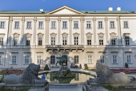 graf: SALZBURG, AUSTRIA - SEPTEMBER 09, 2015: Unrecognized people walk along palace and Pegasus fountain in world famous Gardens of Mirabell. The Gardens were redesigned around 1690 under Graf von Thun.