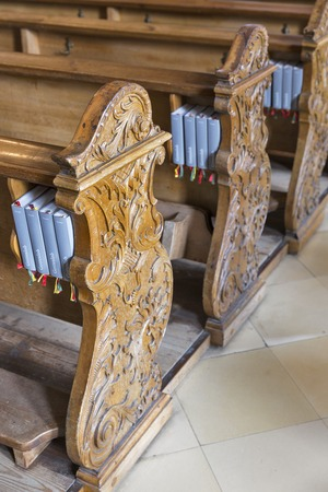 songbook: Wooden benches with German language Gotteslobs for the Christians, in Austrian temple. Gotteslob is a liturgical songbook used in the German speaking Catholic parishes.