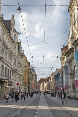 unrecognized: GRAZ, AUSTRIA - SEPTEMBER 11, 2015: Unrecognized people walk along tram rails on Herrengasse street in Graz Old Town. Graz is the capital of federal state of Styria and second largest city in Austria. Editorial