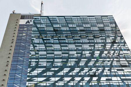 hosts: GRAZ, AUSTRIA - SEPTEMBER 11, 2015: The Telekom highrise tower A1 building facade. It hosts the headquarters of A1 Telekom Austria telecommunications company.