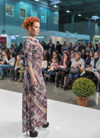 checkered skirt: KIEV, UKRAINE - FEBRUARY 04, 2016: Fashion model at Kyiv Fashion 2016 show in KyivExpoPlaza exhibition center. It was the 30th edition of the popular Kyiv Fashion International Vogue Festival. Editorial