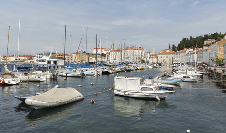 motorboats: PIRAN, SLOVENIA - SEPTEMBER 16, 2015: Motorboats and yachts moored in  Marina of coastal town. With narrow streets and compact houses Piran is a town in southwestern Slovenia on the Adriatic Sea. Editorial