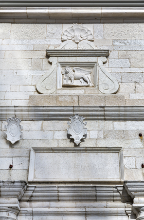 bas: Ancient stone wall with bas relief in Piran, Slovenia