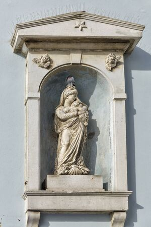 bas: Ancient stone wall with Virgin Mary bas relief in Piran, Slovenia Stock Photo