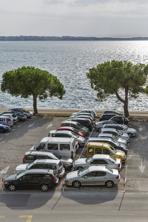 filled: Car parking lot with cars on the seafront. Adriatic Sea, Slovenia. Stock Photo