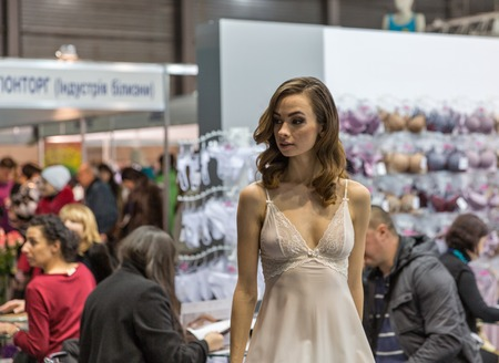 peignoir: KIEV, UKRAINE - FEBRUARY 04, 2016: Fashion lingerie model at Kyiv Fashion 2016 show in KyivExpoPlaza exhibition center. It was the 30th edition of popular Kyiv Fashion International Vogue Festival.