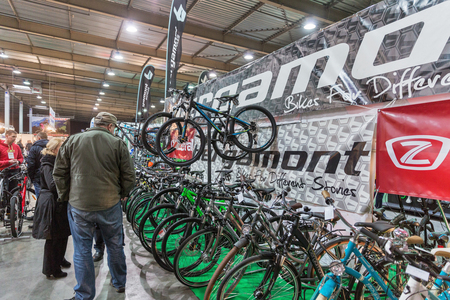 unrecognized: KIEV, UKRAINE - FEBRUARY 26, 2016: Unrecognized people visit Bergamont German bicycle manufacturer booth during International Bicycle Exhibition VELOBIKE 2016 in KyivExpoPlaza Center.