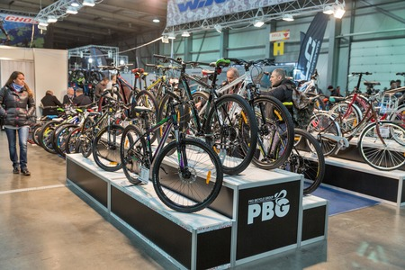 unrecognized: KIEV, UKRAINE - FEBRUARY 26, 2016: Unrecognized people visit Pro Bicycle Group or PBG company trade booth during International Bicycle Exhibition VELOBIKE 2016 in KyivExpoPlaza Center.