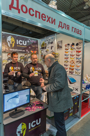 international internet: KIEV, UKRAINE - FEBRUARY 26, 2016: Unrecognized people visit ICU internet shop, sports and protective goggles trade booth during International Bicycle Exhibition VELOBIKE 2016 in KyivExpoPlaza Center. Editorial