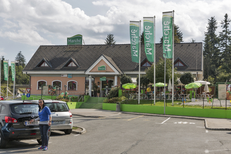 frequented: LOGATEC, SLOVENIA - SEPTEMBER 09, 2015: Unrecognized people in front of Marche Lom 1 highway restaurant. Swiss Marche International specializes in gastronomic concepts at highly frequented locations.