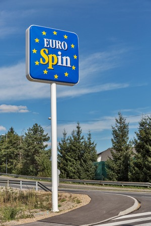 lower value: BREZOVICA, SLOVENIA - SEPTEMBER 22, 2015: Eurospin discount store logo on the road. It is an Italian retail store chain which sells products at prices lower than the typical market value. Editorial
