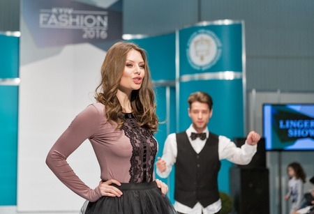 peignoir: KIEV, UKRAINE - FEBRUARY 05, 2016: Anabel Arto lingerie show model at Kyiv Fashion 2016 in KyivExpoPlaza exhibition center. It was 30th edition of popular Kyiv Fashion International Vogue Festival.