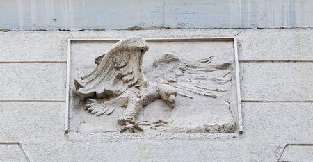 bas relief: Maribor old decorated house facade with eagle bas relief closeup, Slovenia Stock Photo