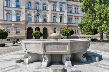 secondary school: Fountain in front of Maribor secondary school building in Slovenia. The building of the school was planned by Graz based architect Wilhelm Bucherja and built in 1873 in classical style. Editorial