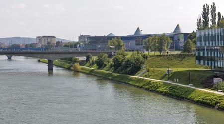 drava: MARIBOR, SLOVENIA - SEPTEMBER 13, 2015: Cityscape with Drava River and big modern shopping center Europark Maribor. Maribor is the second largest city of Slovenia. Editorial