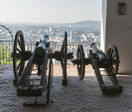 muzzleloader: Old cannon on gun carriage aims to Graz cityscape, Austria