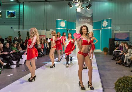 peignoir: KIEV, UKRAINE - FEBRUARY 04, 2016: Anabel Arto lingerie show models at Kyiv Fashion 2016 in KyivExpoPlaza exhibition center. It was 30th edition of popular Kyiv Fashion International Vogue Festival. Editorial