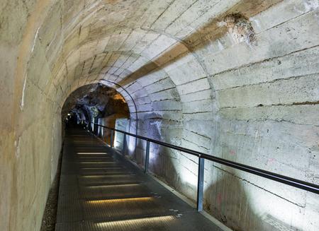 ancient pass: Pedestrian Schlossberg Tunnel. It connects Schlossbergplatz and Karmeliterplatz in Graz, Austria. Editorial