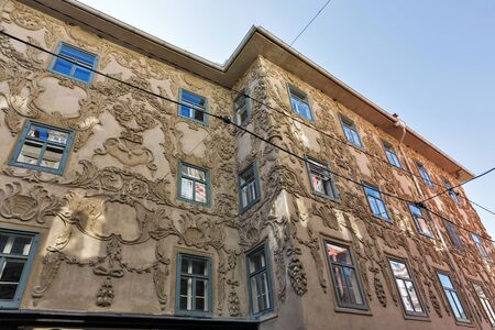 stucco facade: GRAZ, AUSTRIA - SEPTEMBER 12, 2015: Stucco facade of Luegghaus or Luegg House on street corner of Hauptplatz and Sporgasse in the Old City. Graz is the second largest city in Austria.
