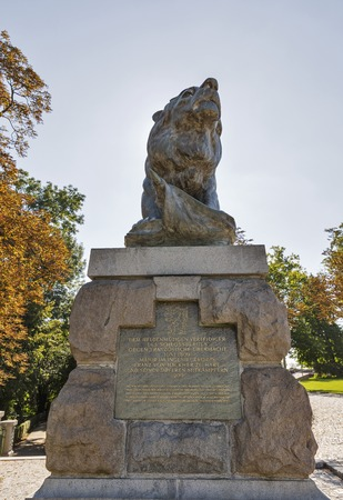 defended: GRAZ, AUSTRIA - SEPTEMBER 12, 2015: Statue of lion on Schlossberg or Castle Hill. It is a memorial to Major Franz von Hackher who defended the Graz Fortress against a superior French force in 1809. Editorial