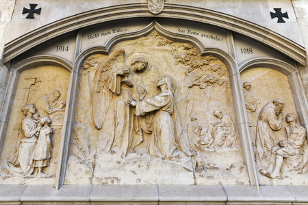 giles: War Memorial, bas relief on the wall of Graz Cathedral dedicated to Saint Giles. Graz, Styria, Austria.