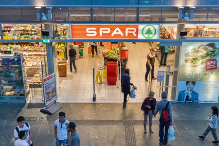 retail chain: GRAZ, AUSTRIA - SEPTEMBER 12, 2015: Unrecognized people visit SPAR supermarket. It is a Dutch multinational retail chain, operates as independent or franchise in 35 countries worldwide.
