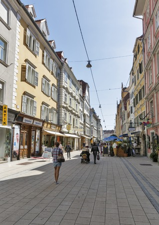 GRAZ, AUSTRIA - SEPTEMBER 11, 2015: Unrecognized people walk along Schmiedgasse street in Graz Old Town. Graz is the capital of federal state of Styria and second largest city in Austria. Editorial