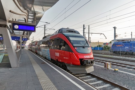 GRAZ, AUSTRIA - SEPTEMBER 12, 2015: OBB passenger train arrived on Hauptbahnhof railway station. OBB Company is a wholly owned subsidiary of OBB-Holding AG, Austria largest mobility service provider.