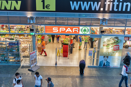 GRAZ, AUSTRIA - SEPTEMBER 12, 2015: Unrecognized people visit SPAR supermarket. It is a Dutch multinational retail chain, operates as independent or franchise in 35 countries worldwide.