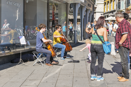 GRAZ, AUSTRIA - SEPTEMBER 12, 2015: Unrecognized young street musicians playing the cello on Hauptplatz square. It is the main square of Graz, the capital of Styria and second largest city in Austria.